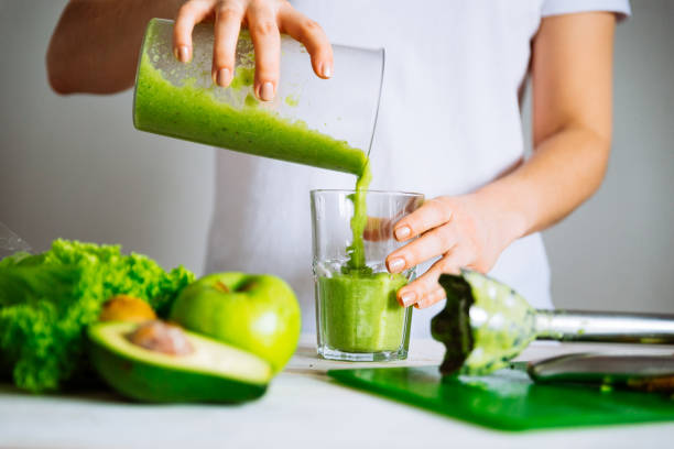 woman-transfuse-smoothie-to-glass-healthy-food-concept